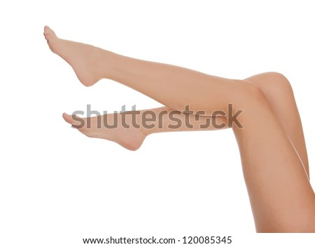 Woman legs in the air, white background - stock photo