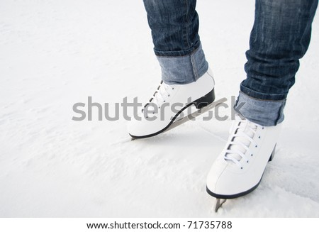 woman legs in white ice skates
