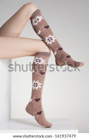 woman legs in winter socks - stock photo
