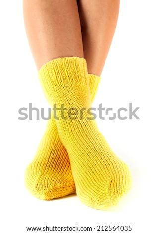woman legs in woolen socks on a white background - stock photo