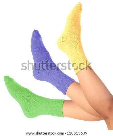 woman legs in woollen socks on a white background. - stock photo