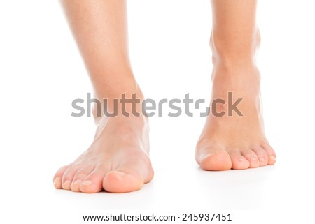 Woman legs isolated foot stepping - stock photo