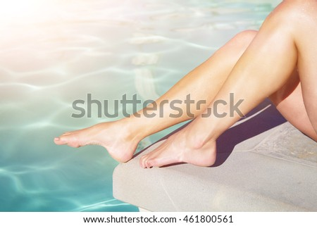 woman legs on pool