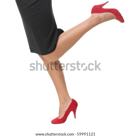 Woman legs running in red high heels - closeup. - stock photo