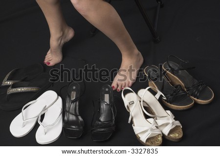 woman legs shot in the center of displayed shoes