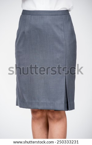 Woman legs with nylons and pencil skirt isolated on a white background - stock photo