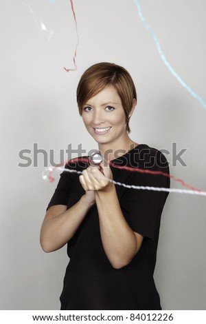 woman letting of a party popper