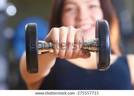 woman lifts dumbbells - stock photo