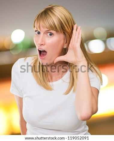 Woman Listening Gossip against a city by night - stock photo