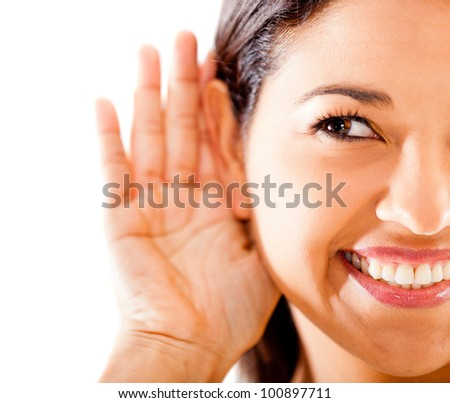 Woman listening - isolated over a white background - stock photo