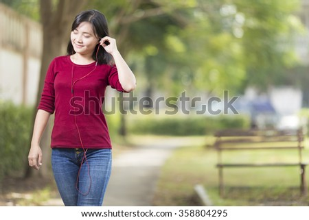 Woman Listening Music for Relaxation at Park