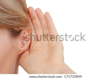 Woman listening to gossip on the white background. Copy space. - stock photo