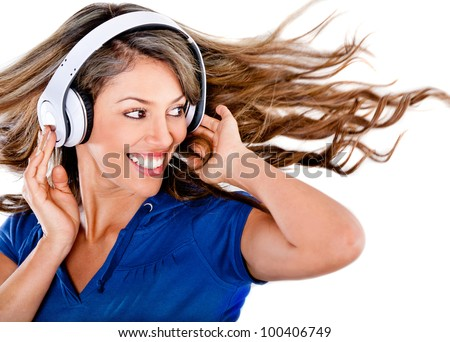 Woman listening to music and having fun - isolated over a white background - stock photo