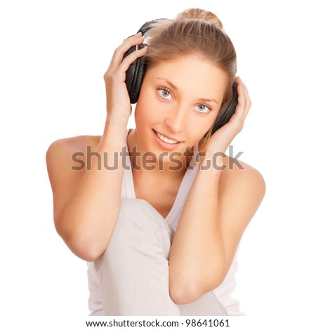 woman listening to music isolated on white background - stock photo