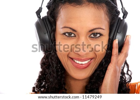 Woman listening to music isolated over a white background - stock photo