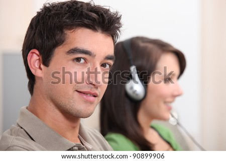 Woman listening to music next to her boyfriend - stock photo