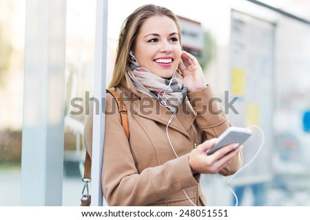 Woman listening to music with smartphone