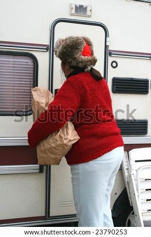 Woman living in a trailer - stock photo