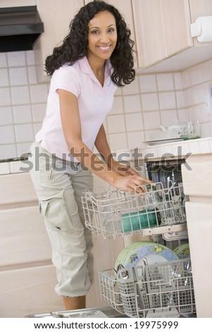 Woman Loading Dishwasher - stock photo