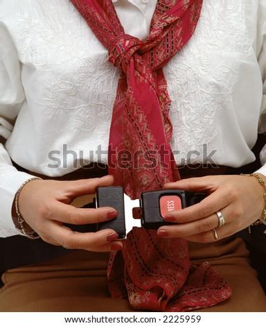 woman locking a fasten seat belt - stock photo