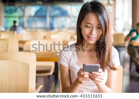 Woman look at cellphone - stock photo