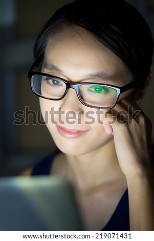 Woman look at computer screen at night - stock photo
