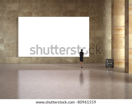 Woman look at the blank frame in art gallery - stock photo