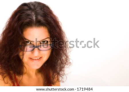 Woman look over glasses isolated on white background. Copy space. - stock photo