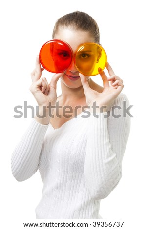 Woman look through color glasses like circle