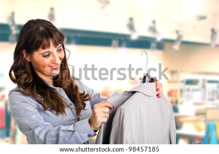 Woman looking at a dress - stock photo