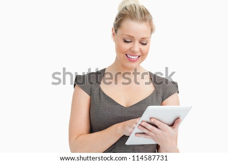 Woman looking at a tablet computer against white background - stock photo