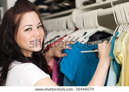 Woman looking at clothes in a closet - stock photo