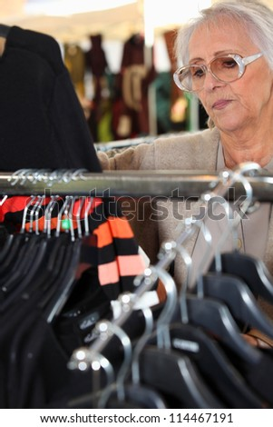 Woman looking at clothing - stock photo