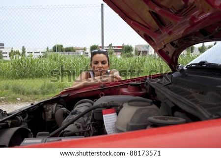 woman looking at engine - stock photo
