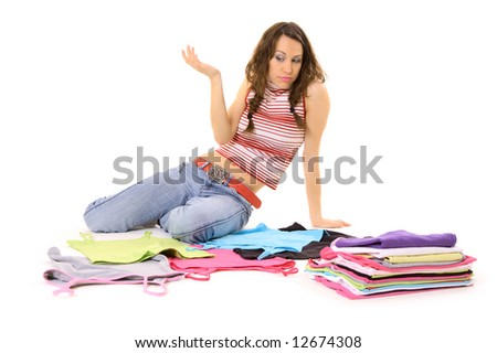 woman looking at her clothes and don't know what to wear