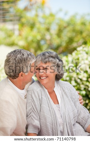 Woman looking at her husband in the garden