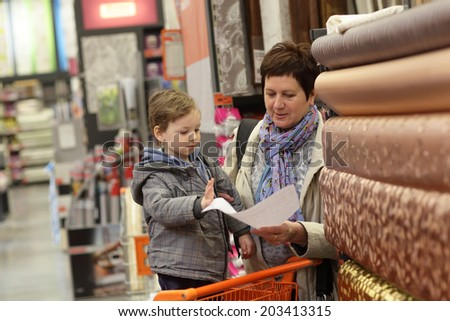 Woman looking at invoice in the store - stock photo