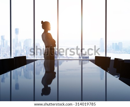 woman looking at modern city - stock photo