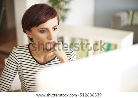 Woman looking at monitor screen