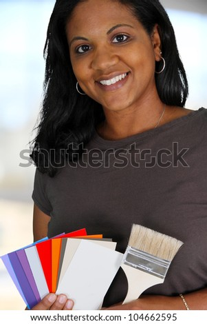 Woman looking at paint chips to use