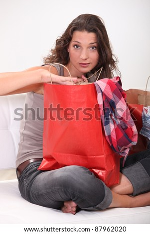 Woman looking at purchases - stock photo