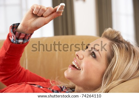 Woman Looking At Result Of Home Pregnancy Test Kit - stock photo