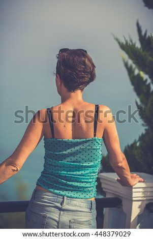 Woman looking at seascape with bay at Zakynthos. - stock photo