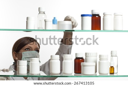 Woman looking at the tube on the shelf - stock photo
