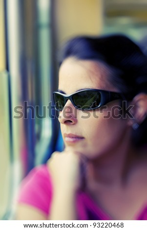 Woman looking at the window of a train - stock photo