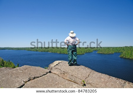 woman looking at view from Winchell Lake Overlook - stock photo