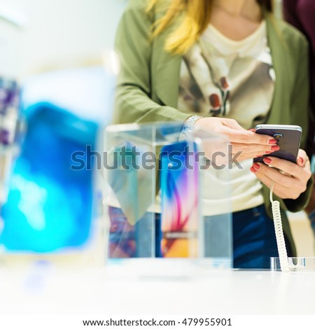 Woman looking for a new smart phone.