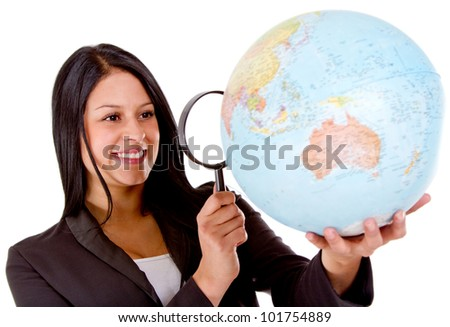 Woman looking for her next tavel destination with a magnifying glass - isolated - stock photo
