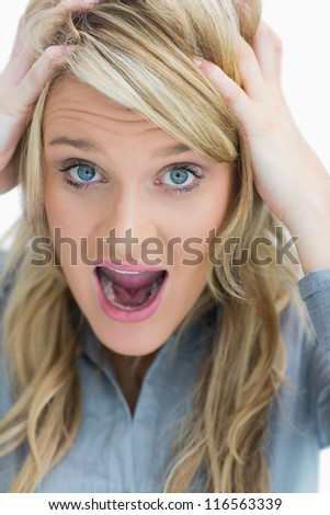 Woman looking frustrated and screaming - stock photo