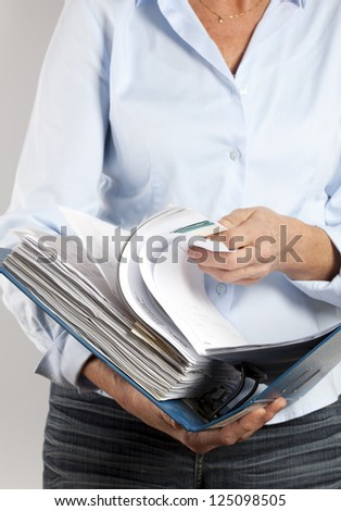 woman looking in a binder